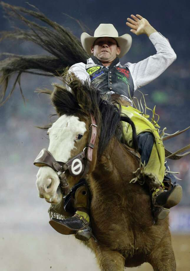 Bobby Mote scored an 86 in bareback riding Tuesday to advance. Photo: Melissa Phillip, Staff / © 2014  Houston Chronicle