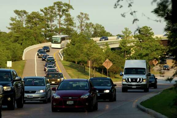 Traffic exits off Interstate 45 onto The Woodlands Parkway flyover in 2012. A parkway extension is proposed.