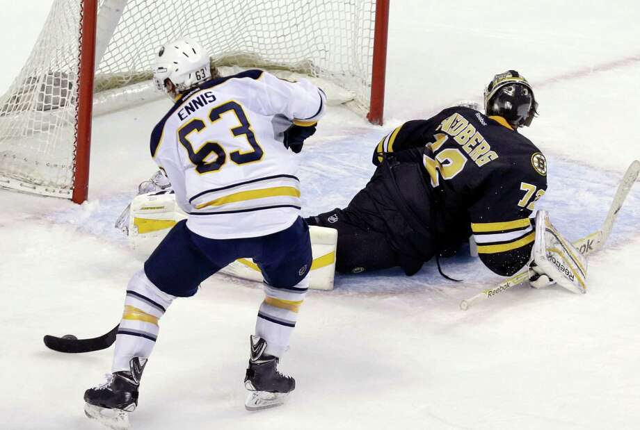 Buffalo Sabres left wing Tyler Ennis (63) has Boston Bruins goalie Niklas Svedberg (72) faked out and turned away as he is able to score during the shootout of an NHL hockey game in Boston, Tuesday, March 17, 2015. The Sabres won 2-1. (AP Photo/Elise Amendola) ORG XMIT: MAEA106 Photo: Elise Amendola / AP
