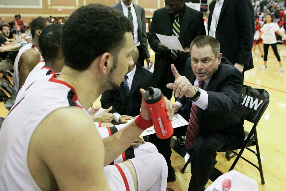 UIW coach Ken Burmeister talks to the Cardinals during the second half of their first round game with Louisiana-Lafayette in the CollegeInsider.com Tournament at the McDermott Convocation Center on March 17, 2015. Photo: Marvin Pfeiffer /San Antonio Express-News / Express-News 2015