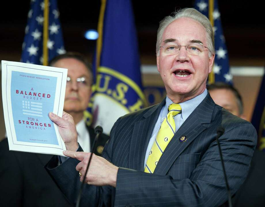 House Budget Committee Chairman Rep. Tom Price, R-Ga. holds-up a synopsis of the House Republican budget proposal as he announces the plan on Capitol Hill in Washington, Tuesday, March 17, 2015. The plan includes a boost in defense spending but cuts in the Medicaid program for the poor, food stamps and health care subsidies. (AP Photo/Cliff Owen) Photo: Cliff Owen, FRE / Associated Press / FR170079 AP