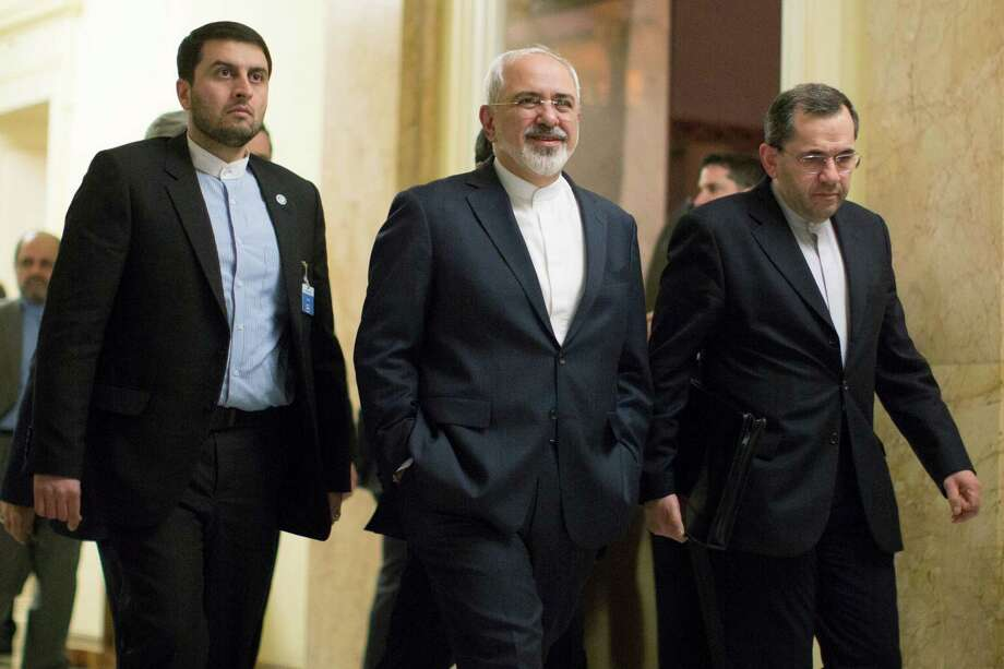 Iran's Foreign Minister Mohammad Javad Zarif, center, walks away after talks with United States Secretary of State John Kerry in Lausanne, Switzerland, Tuesday March 17, 2015. Top U.S. and Iranian diplomats returned to talks on Tuesday, trying to resolve differences blocking a deal that would curtail Iran's nuclear program and ease sanctions on the country. (AP Photo/Brian Snyder, Pool) Photo: Brian Snyder, POOL / Associated Press / Reuters Pool