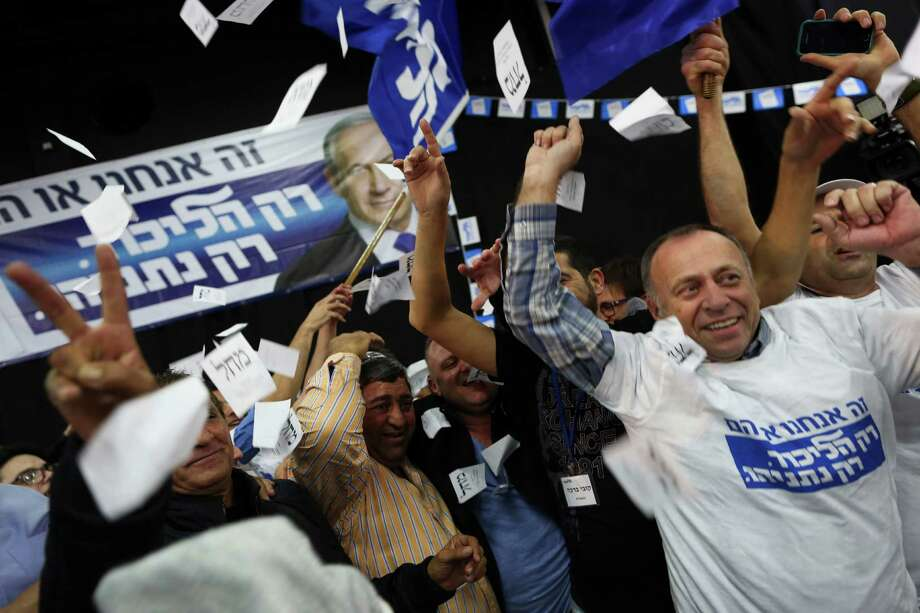 Likud Party supporters celebrate news about exit polling during the Iraeli parliamentary elections.<252><137,2015/03/17,Bob Kolarik1>Israeli Prime Minister Benjamin Netanyahu Likud party supporters react to exit poll results at the party's election headquarters In Tel Aviv.Tuesday, March 17, 2015. Israelis are voting in early parliament elections following a campaign focused on economic issues such as the high cost of living, rather than fears of a nuclear Iran or the Israeli-Arab conflict. (AP Photo/Oded Balilty)<137> Photo: Oded Balilty /Associated Press / AP