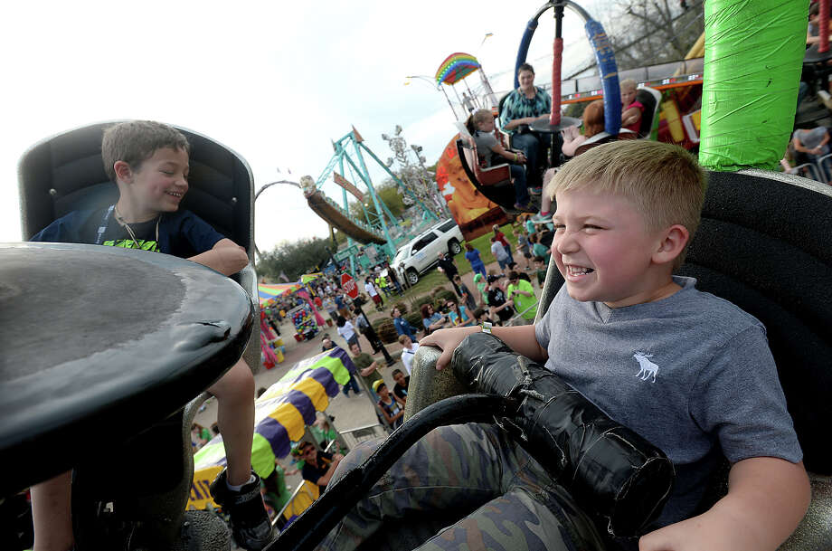 Friends Kaden Thibodeaux, 6, (left) and Luke Pelt, 6, enjoy the sights from up high as they ride on the Tornado on the opening night of the Nederland Heritage Festival Tuesday. The event continues throughout the weekend on Boston Avenue.  Photo taken Tuesday, March 17, 2015  Kim Brent/The Enterprise Photo: Kim Brent / Beaumont Enterprise
