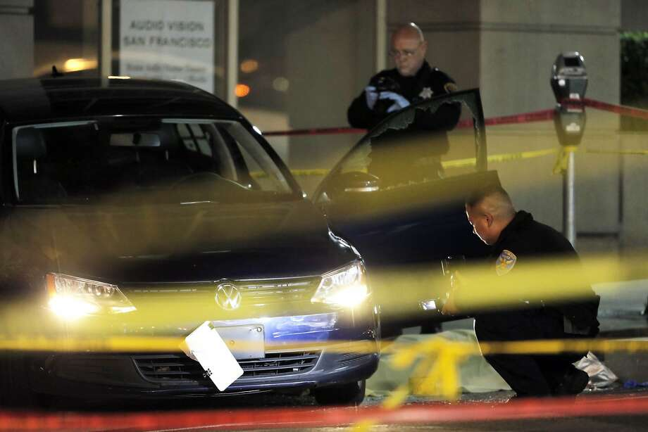 San Francisco Police investigators examine the scene of a police-involved shooting on Pine Street at Van Ness in San Francisco, Calif., on Tuesday, March 17, 2015. Photo: Carlos Avila Gonzalez, The Chronicle