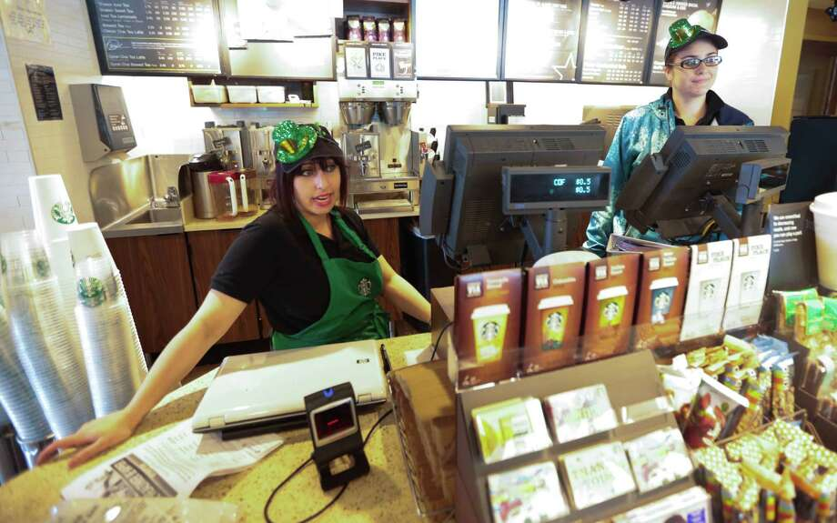 The Rice Village Starbucks store on University Boulevard will close this weekend and relocate to a larger store on Amherst this fall. Photo: Billy Smith II, Chronicle / © 2015 Houston Chronicle