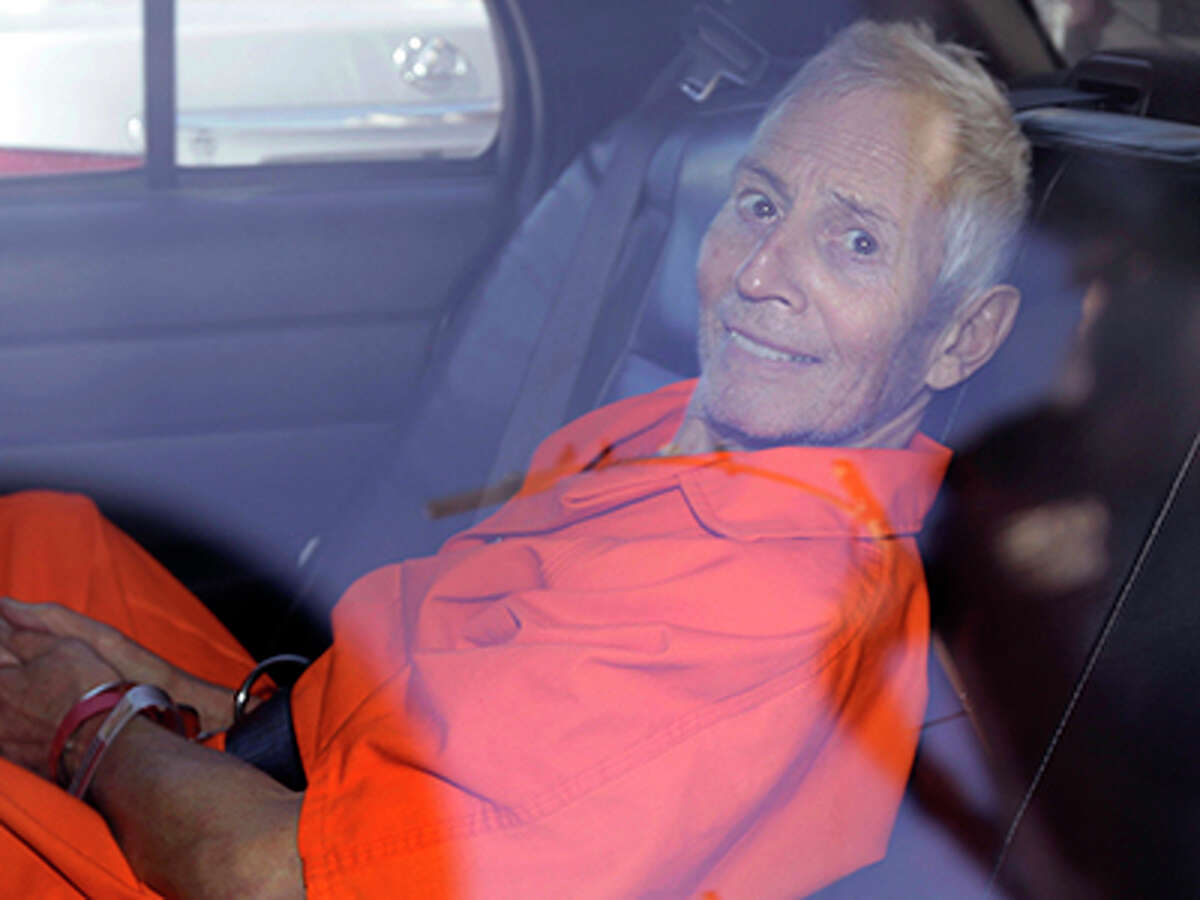 Robert Durst is transported from Orleans Parish Criminal District Court to the Orleans Parish Prison after his arraignment in New Orleans, Tuesday, March 17, 2015. Durst was rebooked on charges of being a convicted felon in possession of a firearm, and possession of a weapon with a controlled dangerous substance, a small amount of marijuana.
