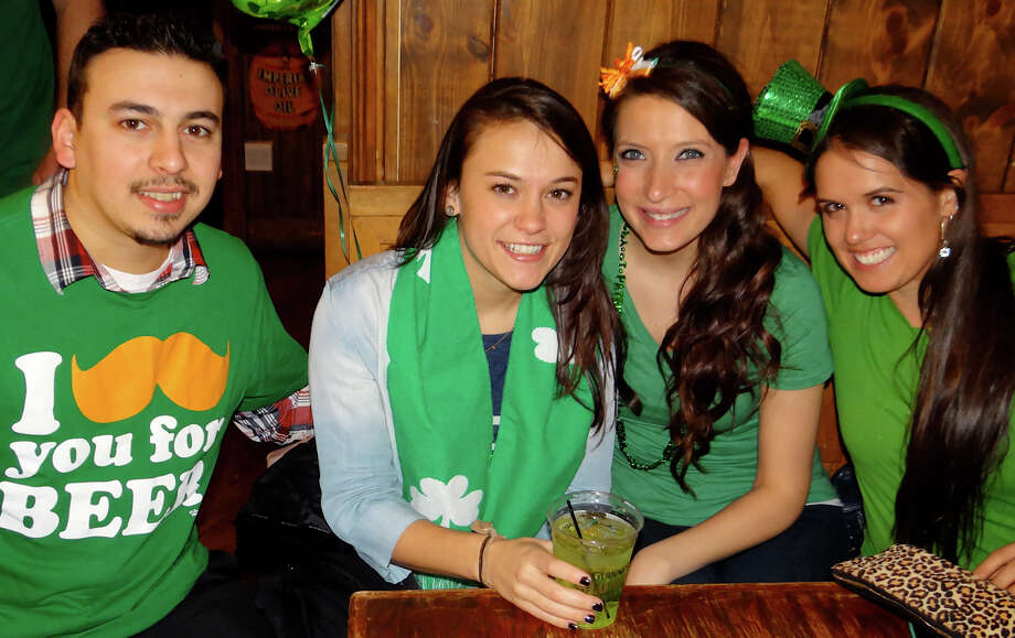Irish for a day: Justin and Alexandra Gouveia, Stephanie Gaspar and Jessica Sergiacomi celebrating St. Patrick's Day at Anna Liffey's on Tuesday night. Photo: Mike Lauterborn / Fairfield Citizen