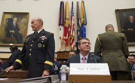 Defense Ash Carter and Joint Chiefs Chairman Gen. Martin Dempsey arrive on Capitol Hill in Washington, Wednesday, March 18, 2015, to testify before the House Armed Services Committee hearing on President Obama's use of military force proposal against IS, and the Defense Department's budget. (AP Photo/Molly Riley)