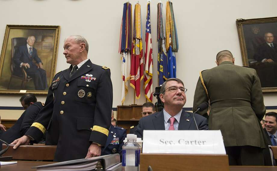 Defense Ash Carter and Joint Chiefs Chairman Gen. Martin Dempsey arrive on Capitol Hill in Washington to testify before the House Armed Services Committee hearing on President Obama's use of military force proposal against Islamic State, and the Defense Department's budget. Photo: Molly Riley, Associated Press