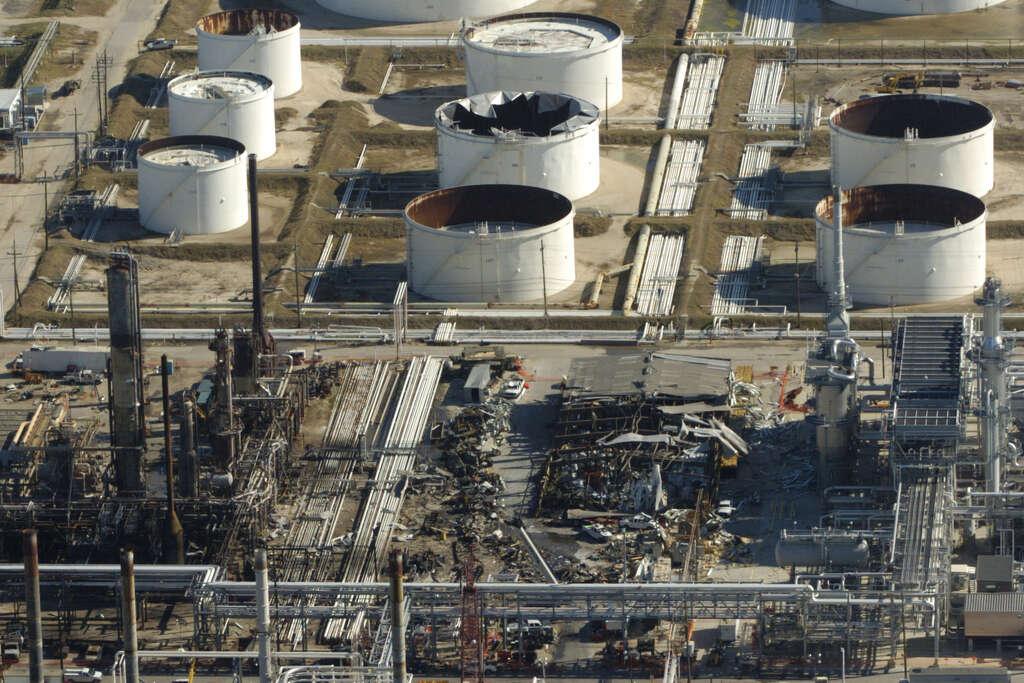 Damaged Storage Tanks And A Destroyed Trailer Are Seen By The Blast Site At Refinery