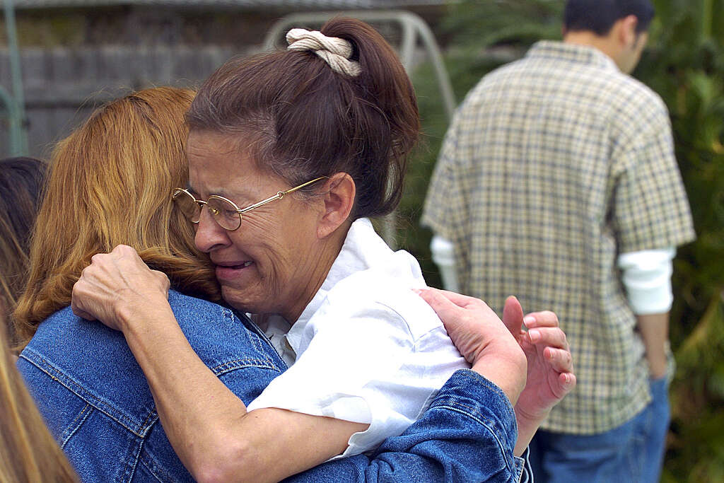 Juanita Ramos, widow of victim Art Ramos, embraces Margaret Jasso three days after the explosion.