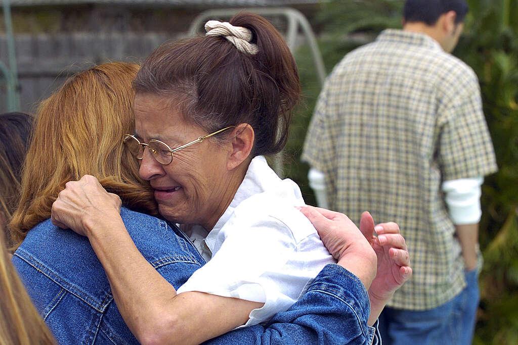 Juanita Ramos, widow of victim Art Ramos, embraces Margaret Jasso three days after the explosion.