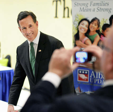 Former presidential candidate Rick Santorum poses for pictures  during the New York Family Research Foundation's lobby day at the Convention Center at the Empire State Plaza Tuesday March 17, 2015 in Albany, NY.  (John Carl D'Annibale / Times Union) Photo: John Carl D'Annibale, Albany Times Union / 00031052A