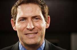 Steve Young, former Super Bowl-winning quarterback for the San Francisco 49ers is seen in his office at Huntsman Gay Global Capital where he is a managing partner on Monday, Jan. 28, 2013 in Palo Alto, Calif.