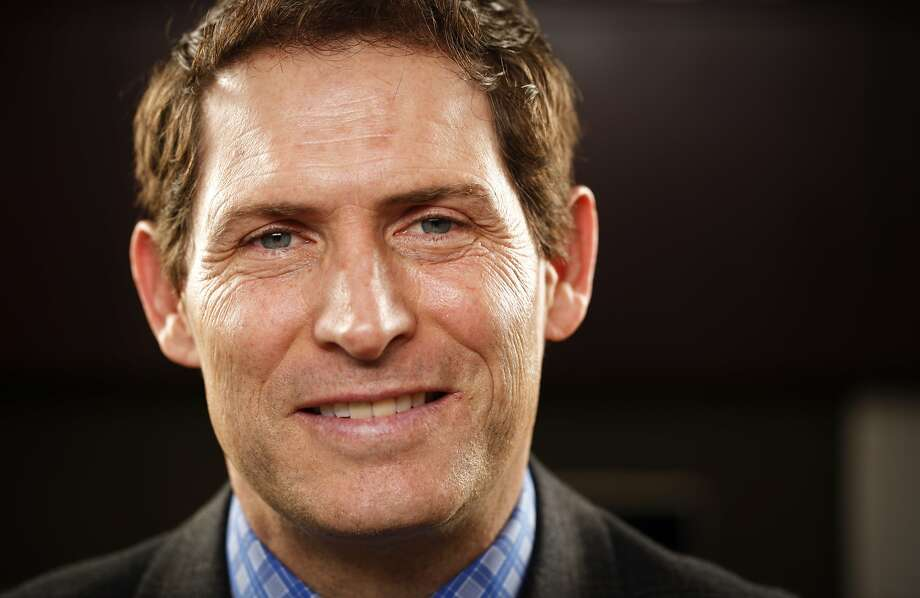Steve Young, former Super Bowl-winning quarterback for the San Francisco 49ers is seen in his office at Huntsman Gay Global Capital where he is a managing partner on Monday, Jan. 28, 2013 in Palo Alto, Calif. Photo: Russell Yip/San Francisco Chroni