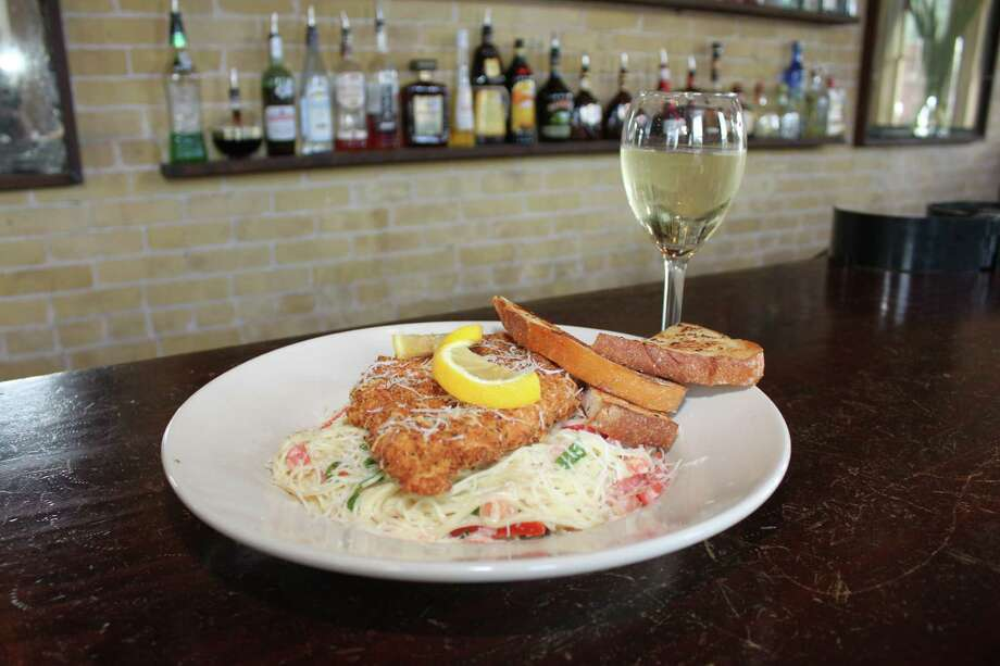 Mozie's in New Braunfels is offering an off-menu special: Panko Parmesan chicken served with angel hair pasta tossed in a creamy chipotle sauce with red peppers, fresh spinach and tomatoes, $12.99. Photo: Courtesy Photo