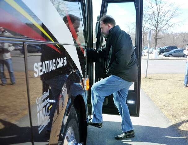 University at Albany head coach Will Brown walks onto a bus at the college on Wednesday, March 18, 2015, in Albany, N.Y.   The team was heading to the airport to fly to Columbus for the NCAA Tournament.  (Paul Buckowski / Times Union) Photo: PAUL BUCKOWSKI / 00031071A