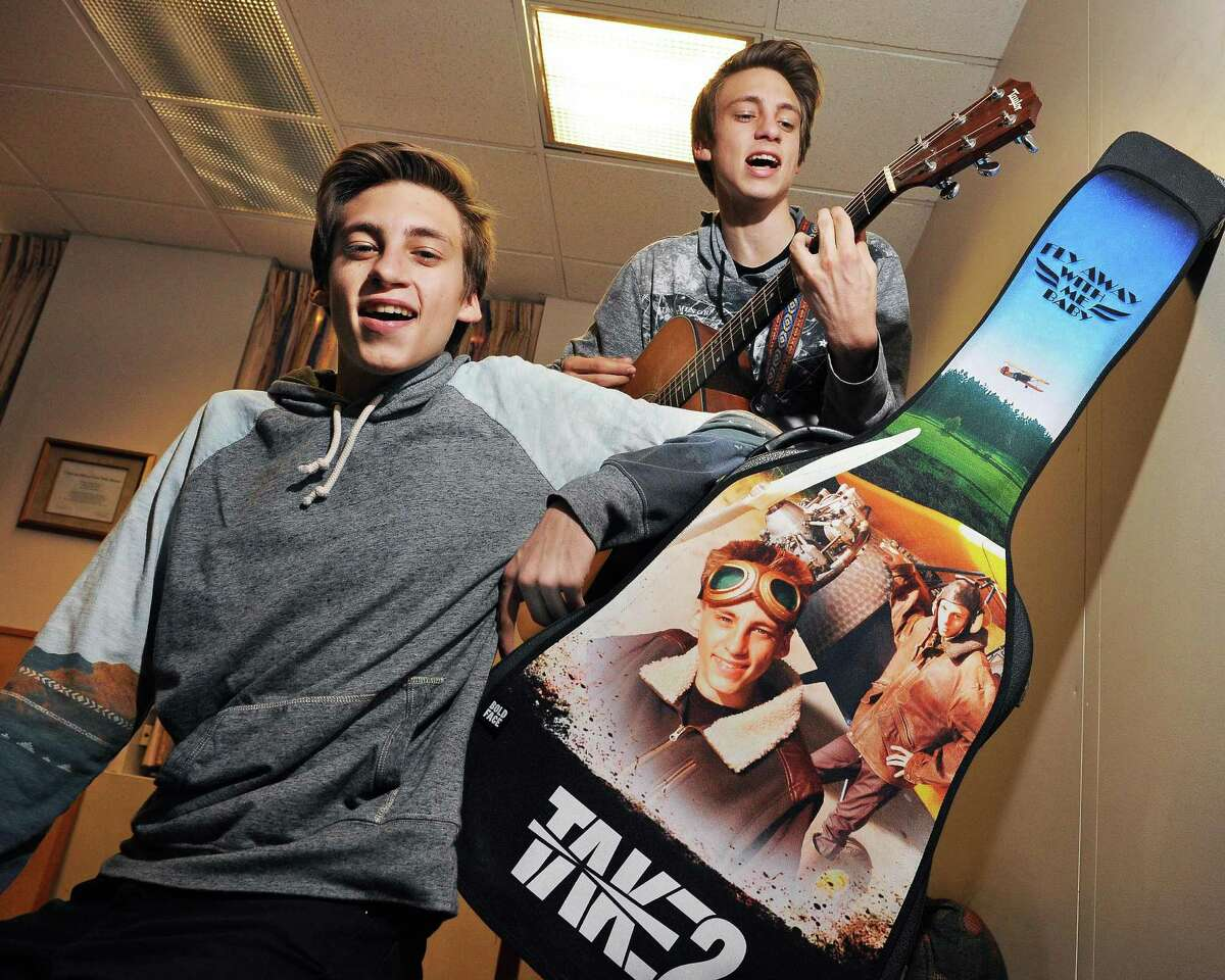 Twin guitar players Julian, left, and Adrian Woodrow of Sunderland, Vt., play some of their music during an interview at the Times Union Thursday March 12, 2015 in Colonie, NY. (John Carl D'Annibale / Times Union)
