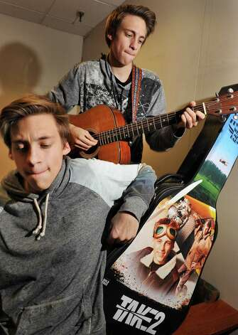 Twin guitar players Julian, left, and Adrian Woodrow of Sunderland, Vt., play some of their music during an interview at the Times Union Thursday March 12, 2015 in Colonie, NY. (John Carl D'Annibale / Times Union) Photo: John Carl D'Annibale / 00031016A