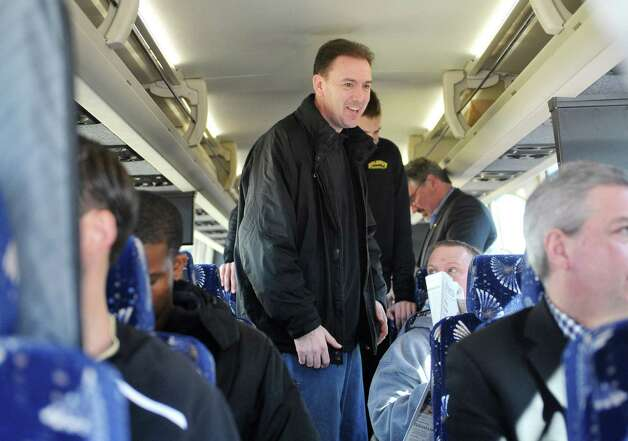 University at Albany head coach Will Brown talks with people on a bus at the college on Wednesday, March 18, 2015, in Albany, N.Y.   The team was heading to the airport to fly to Columbus for the NCAA Tournament.  (Paul Buckowski / Times Union) Photo: PAUL BUCKOWSKI / 00031071A