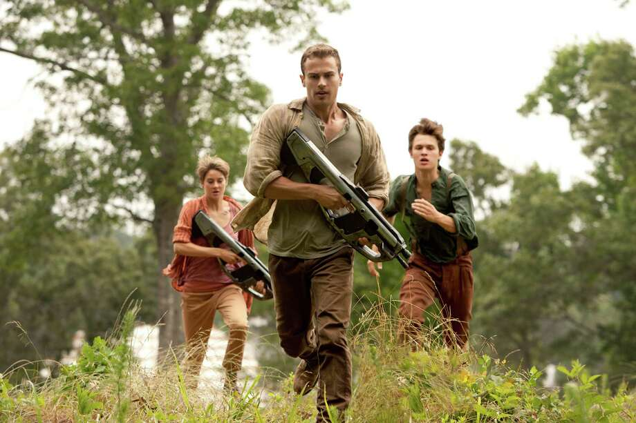 "In this image released by Lionsgate, Theo James, center, Shailene Woodley and Ansel Elgort appear in a scene from ""The Divergent Series: Insurgent."" (AP Photo/Lionsgate, Andrew Cooper) ORG XMIT: NYET126 Photo: Andrew Cooper / Lionsgate"