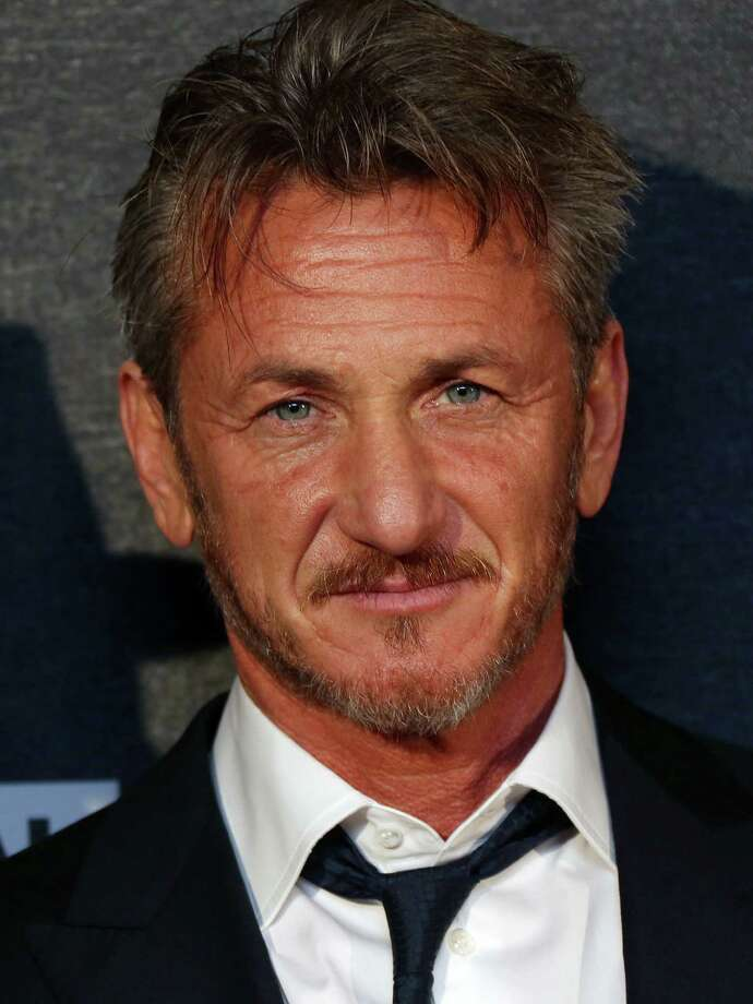 """FILE - In this Feb. 16, 2015 file photo, actor Sean Penn arrives for the World Premiere of """"The Gunman"""" at the BFI south bank cinema, in London. Penn surfs, shoots, sprints, punches and fights for his life in the geopolitical thriller in theaters on Friday, March 20, 2015. (Photo by Joel Ryan/Invision/AP, File) ORG XMIT: CAET971 Photo: Joel Ryan / Invision"""