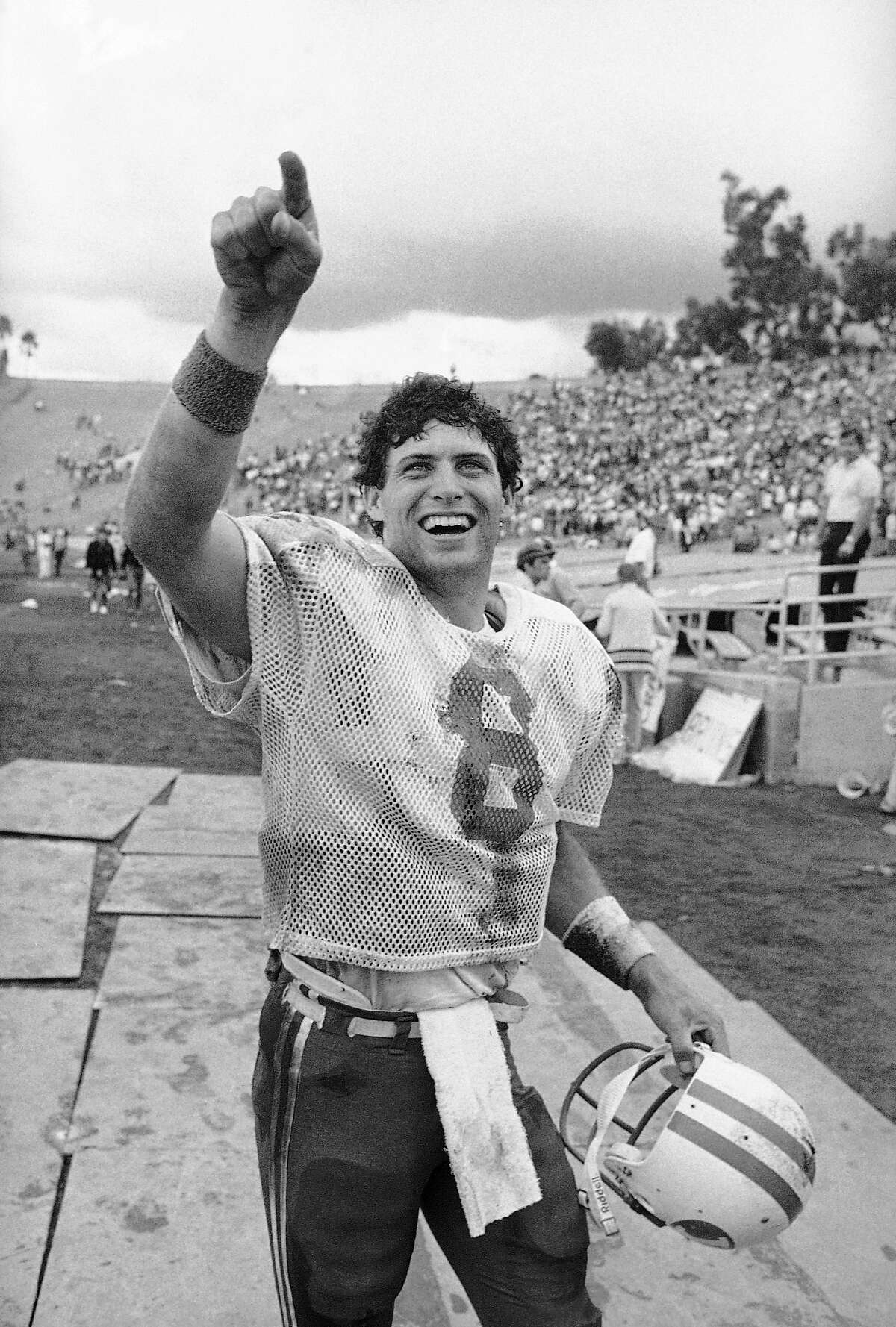 Brigham Young University quarterback Steve Young responds to BYU fans with a