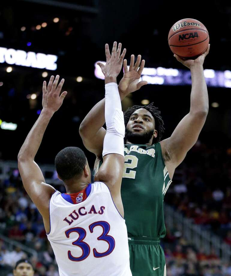 Baylor's Rico Gathers shoots over Kansas' Landen Lucas during the first half of the semifinals of the Big 12 Conference tournament on March 13, 2015, in Kansas City, Mo. Photo: Charlie Riedel /Associated Press / AP