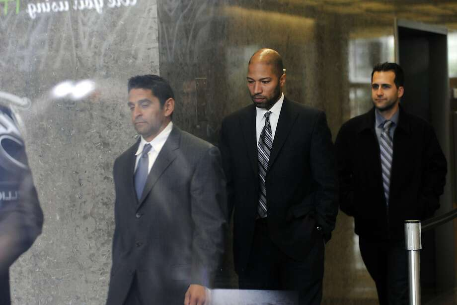 Indicted former San Francisco Police Officer Edmond Robles, left, leaves a courthouse in 2014. Photo: Michael Short, Special To The Chronicle