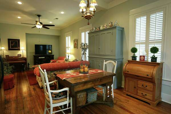 The dining area and living room with original pine wood floors in the home of Betty Paine in New Braunfels.