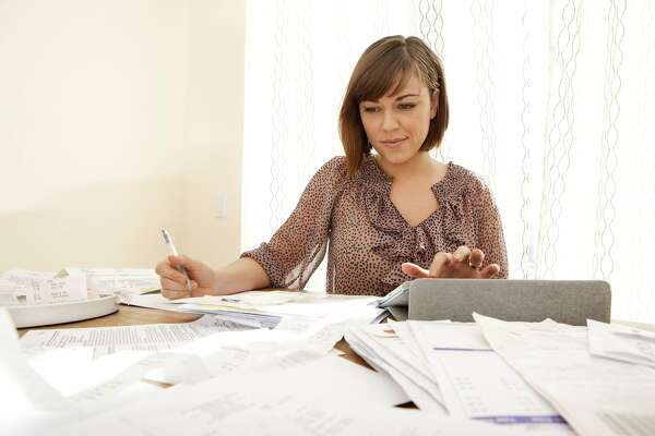 Go through your 2014 receipts and credit card and bank statements and look for purchases that were entirely discretionary that you didn't need to buy. Use the excess cash to fund your retirement plan and or pay down debt.        Woman calculating receipts for taxes