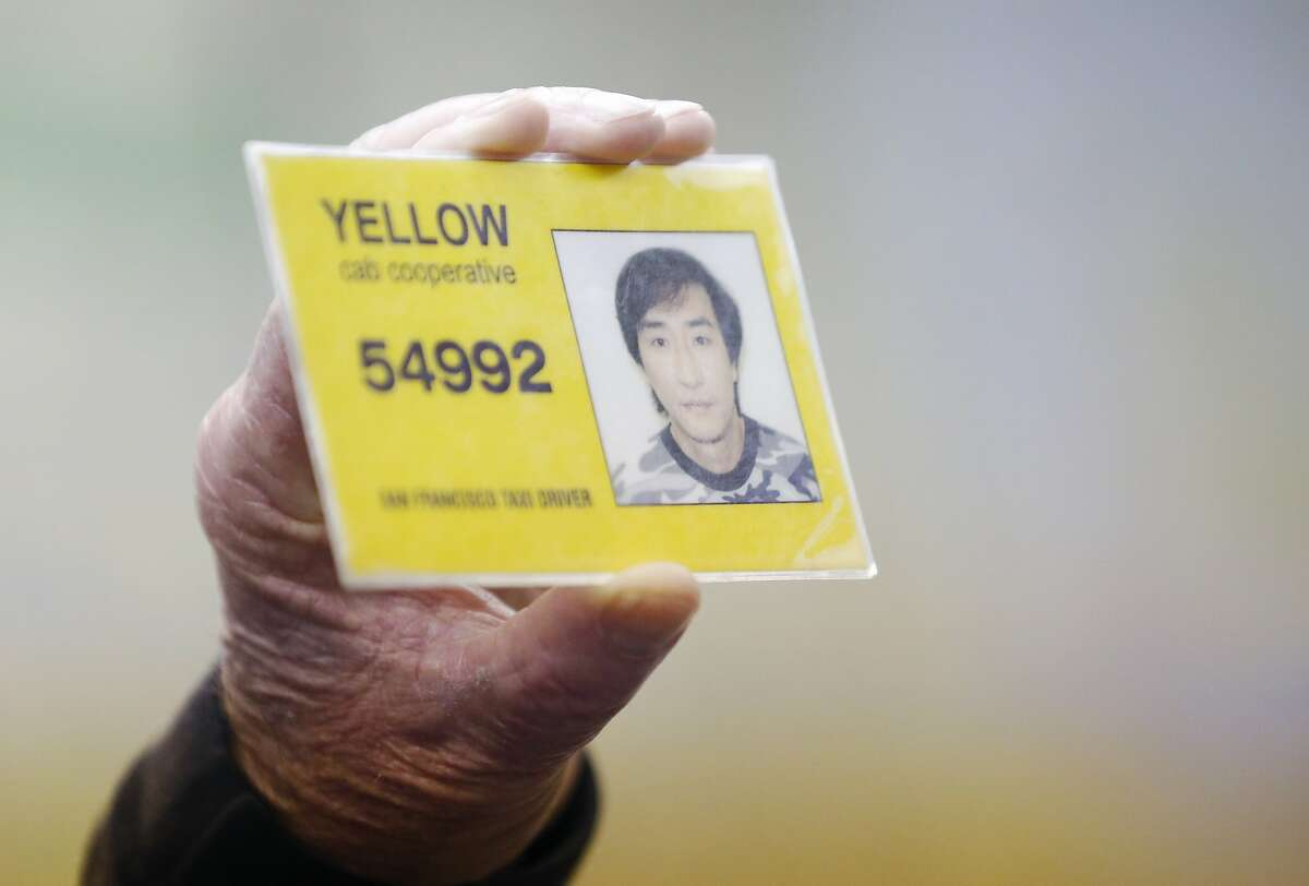 Instructor Mickey Kelley holds up an artificial example of a taxi ID during class at San Francisco Taxi School at the DeSoto Cab and Flywheel headquarters March 18, 2015 in San Francisco, Calif.