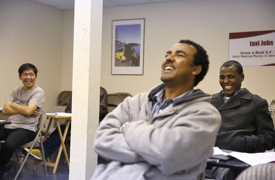 Students Dashzeveg Erdenebileg (left), Yikuno Tesfay and Mesele Teclehaimanot laugh after instructor Mickey Kelley made a joke during class at the Taxi School at the DeSoto Cab and Flywheel S.F. headquarters. Photo: Leah Millis, The Chronicle