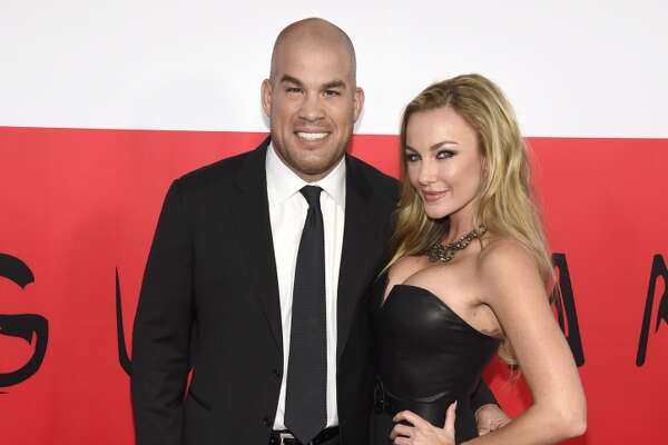 """Tito Ortiz, left, and Amber Miller arrive at the Los Angeles premiere of """"The Gunman"""" at Regal Cinemas LA LIVE on Thursday, March 12, 2015."""