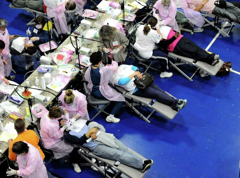 In this file photo patients are treated at the Mission of Mercy dental clinic in the O'Neill Center at Western Connecticut State University in Danbury, Conn. Photo: Michael Duffy / The News-Times