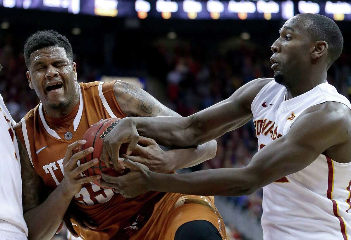 Iowa State's Dustin Hogue (right) tries to steal the ball from Texas' Cameron Ridley during the second half in the quarterfinals of the Big 12 Conference tournament on March 12, 2015, in Kansas City, Mo. Iowa State won 69-67.