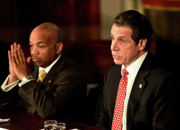 Gov. Andrew Cuomo, right and Speaker Carl Heastie announced details of a two-way ethics reform agreement they reached Tuesday night during a press conference Wednesday morning, March 18, 2015 in the Red Room of the Capitol in Albany, N.Y.   Highlights include a swipe card requirement for lawmakers claiming per diems and detailed outside income disclosure.    (Skip Dickstein/Times Union) Photo: SKIP DICKSTEIN / 10031089A