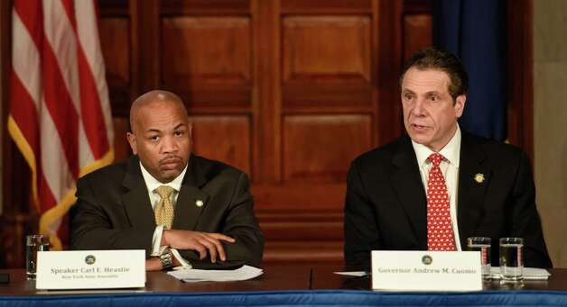 Gov. Andrew Cuomo, right and Speaker Carl Heastie announced details of a two-way ethics reform agreement they reached Tuesday night during a press conference Wednesday morning March 18, 2015 in the Red Room of the Capitol in Albany, N.Y.   Highlights include a swipe card requirement for lawmakers claiming per diems and detailed outside income disclosure.    (Skip Dickstein/Times Union) Photo: SKIP DICKSTEIN / 10031089A