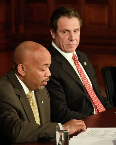 Gov. Andrew Cuomo, right and Assembly Democratic Majority Speaker Carl Heastie announced details of a two-way ethics reform agreement they reached Tuesday night during a press conference Wednesday morning March 18, 2015 in the Red Room of the Capitol in Albany, N.Y.   Highlights include a swipe card requirement for lawmakers claiming per diems and detailed outside income disclosure.    (Skip Dickstein/Times Union) Photo: SKIP DICKSTEIN / 10031089A