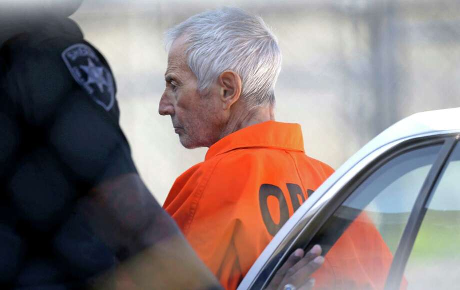 Robert Durst is escorted into Orleans Parish Prison after his arraignment in Orleans Parish Criminal District Court in New Orleans, Tuesday, March 17, 2015.  Durst was rebooked on charges of being a convicted felon in possession of a firearm, and possession of a weapon with a controlled dangerous substance, a small amount of marijuana. Photo: Gerald Herbert, AP / AP