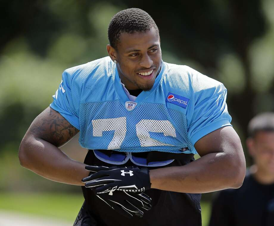 Carolina Panthers' Greg Hardy smiles at fans as he arrives for an NFL football practice in Charlotte, N.C., Thursday, Sept. 11, 2014. Hardy has been convicted on two counts of domestic violence and is still playing. Though he has already been found guilty, the league is sticking by its policy to wait until the appeal process has been heard before making any decision on a possible suspension. (AP Photo/Chuck Burton) Photo: Chuck Burton, Associated Press