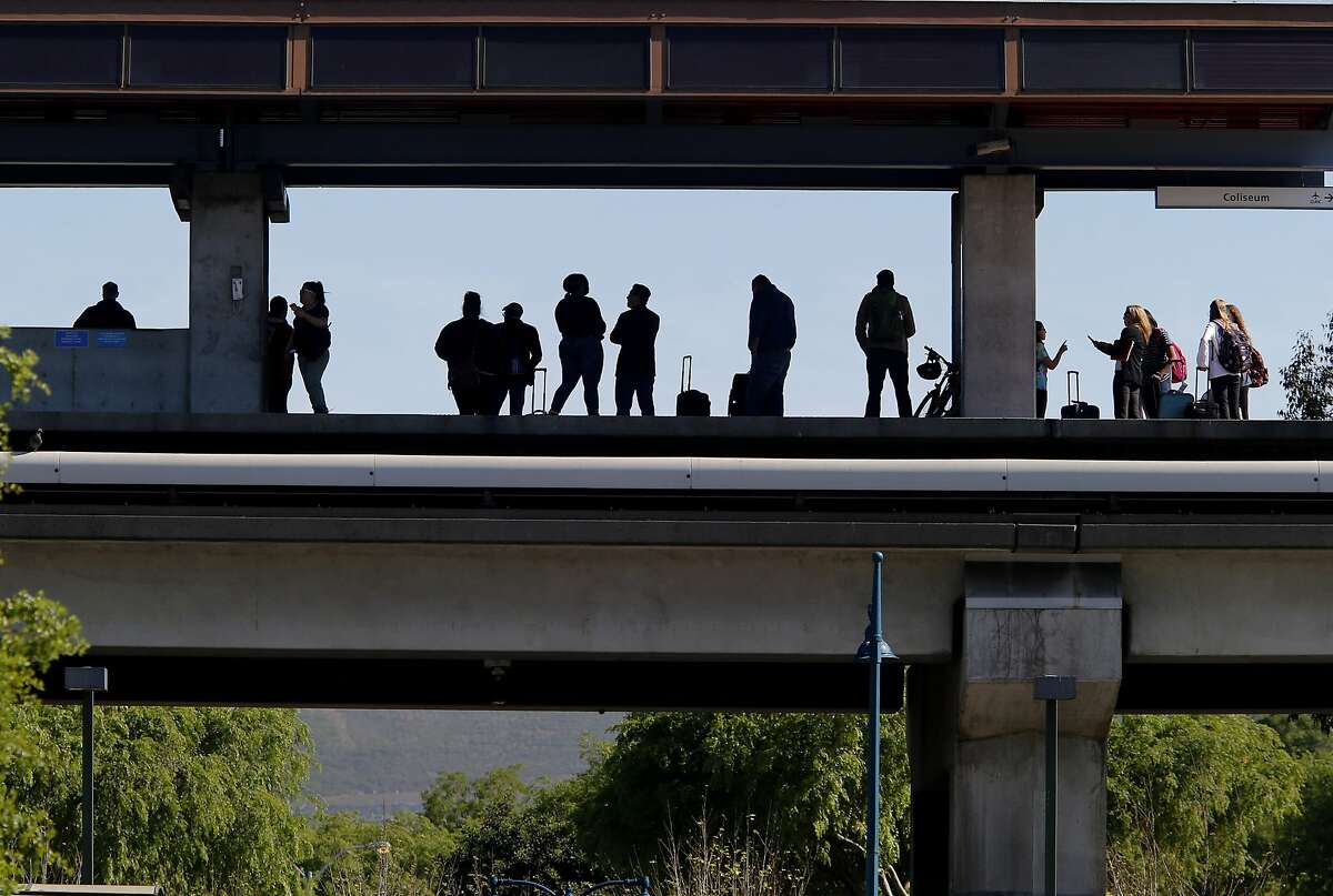 Passengers at the Coliseum station await a southbound train Wednesday March 18, 2015. BART officials announced a major track repair project between the Fruitvale and Coliseum stations beginning in early April.