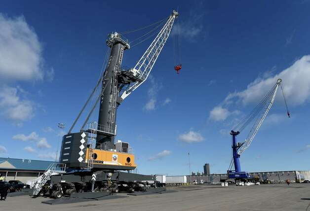 The new crane, left,  unveiled for the public by the Albany Port Commission Wednesday morning March 18, 2015 at the Port of Albany in Albany, N.Y.    (Skip Dickstein/Times Union) Photo: SKIP DICKSTEIN / 00031075A