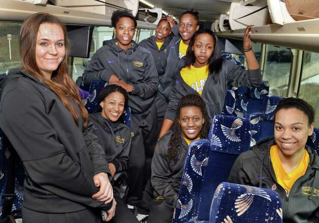 Members of the UAlbany women's basketball team aboard a bus to take them to the airport on their way to the NCAA Tournament Wednesday March 18, 2015, in Albany, NY.  (John Carl D'Annibale / Times Union) Photo: John Carl D'Annibale