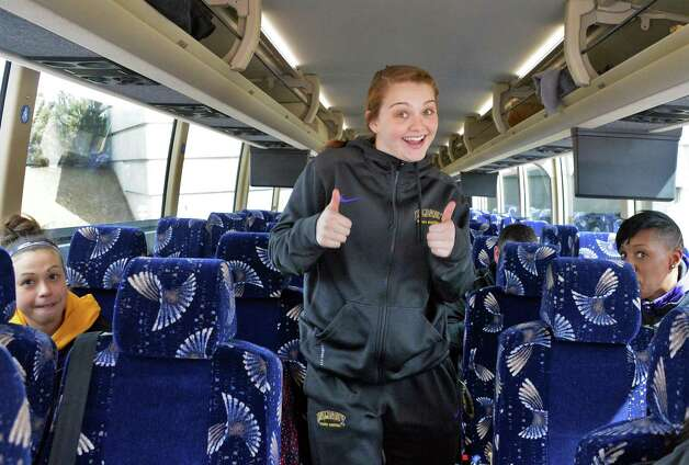 Erin Coughlin, center, gives two thumbs up as the UAlbany women's basketball team boards a bus to take them to the airport on their way to the NCAA Tournament Wednesday March 18, 2015, in Albany, NY.  (John Carl D'Annibale / Times Union) Photo: John Carl D'Annibale