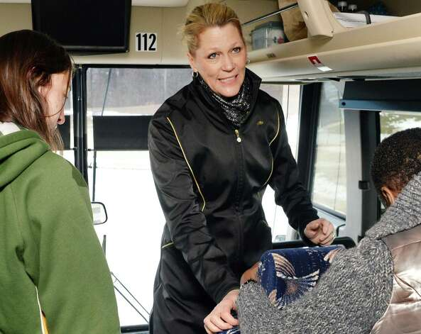 UAlbany head coach Katie Abrahamson-Henderson  -  boards a bus to take the team to the airport on their way to the NCAA Tournament Wednesday March 18, 2015, in Albany, NY.  (John Carl D'Annibale / Times Union) Photo: John Carl D'Annibale