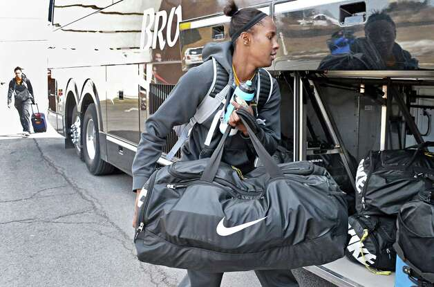 Shereesha Richards stows her bag as the UAlbany women's basketball team boards a bus to take them to the airport on their way to the NCAA Tournament Wednesday March 18, 2015, in Albany, NY.  (John Carl D'Annibale / Times Union) Photo: John Carl D'Annibale