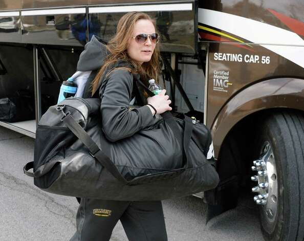 Sarah Royals boards the bus that will take the UAlbany women's basketball team to the airport on their way to the NCAA Tournament Wednesday March 18, 2015, in Albany, NY.  (John Carl D'Annibale / Times Union) Photo: John Carl D'Annibale