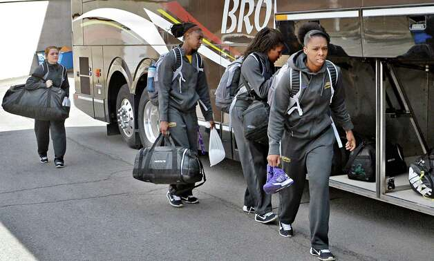 Members of the UAlbany women's basketball team board a bus to take them to the airport on their way to the NCAA Tournament Wednesday March 18, 2015, in Albany, NY.  (John Carl D'Annibale / Times Union) Photo: John Carl D'Annibale